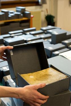 Herverpakken in zuurvrije doos