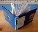 Notitieboekje met diskettes als omslag