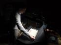 Projectleider Godfried Croenen fotografeert een handschrift